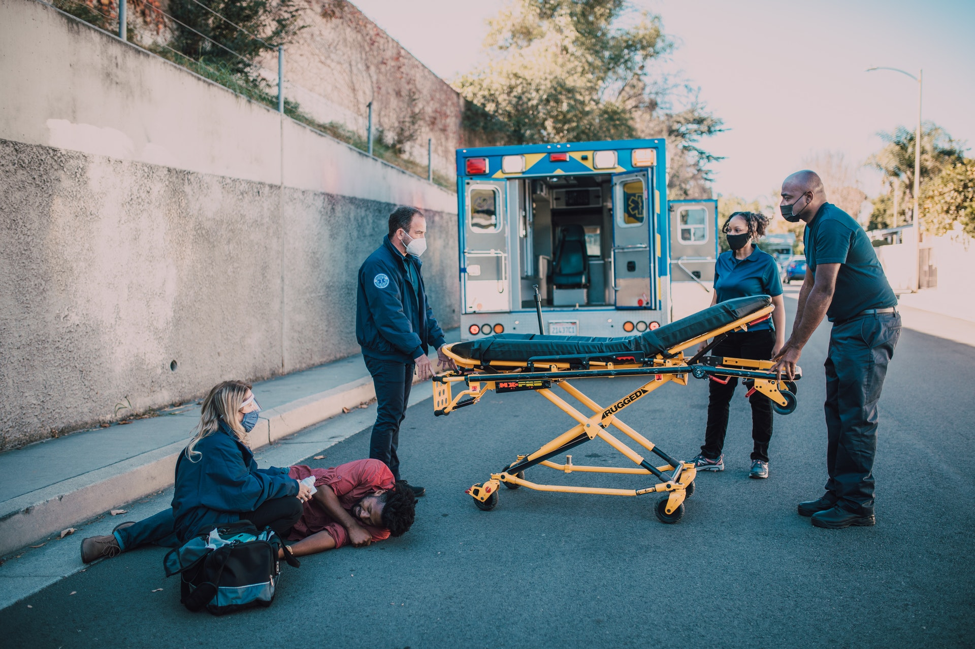 Injured man being tended to by paramedics