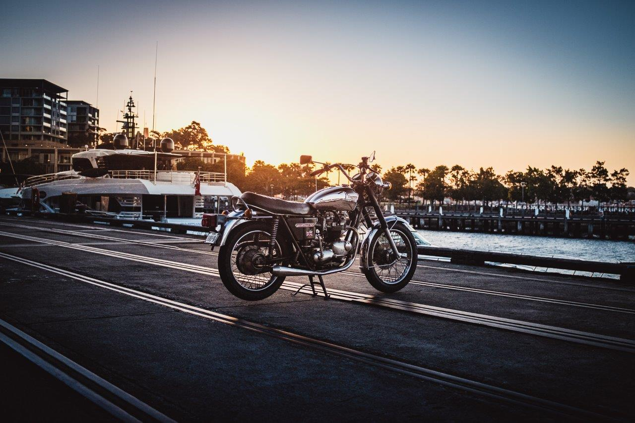 1973 Triumph Bonneville T140V on wharf at sunset