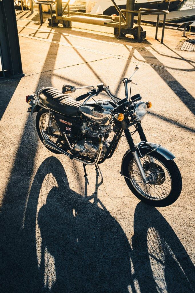 1973 Triumph Bonneville T140V with afternoon sun and shadows