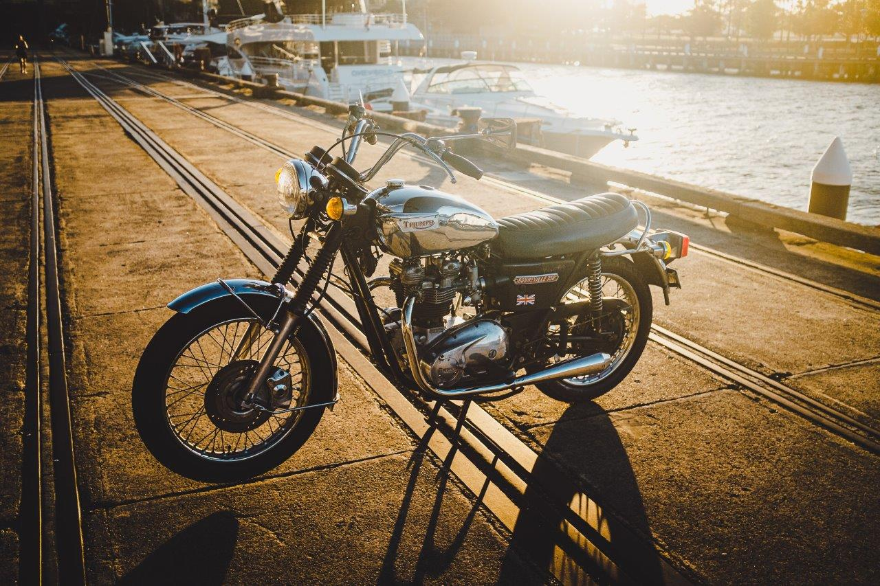 1973 Triumph Bonneville T140V with boats and wharf in background