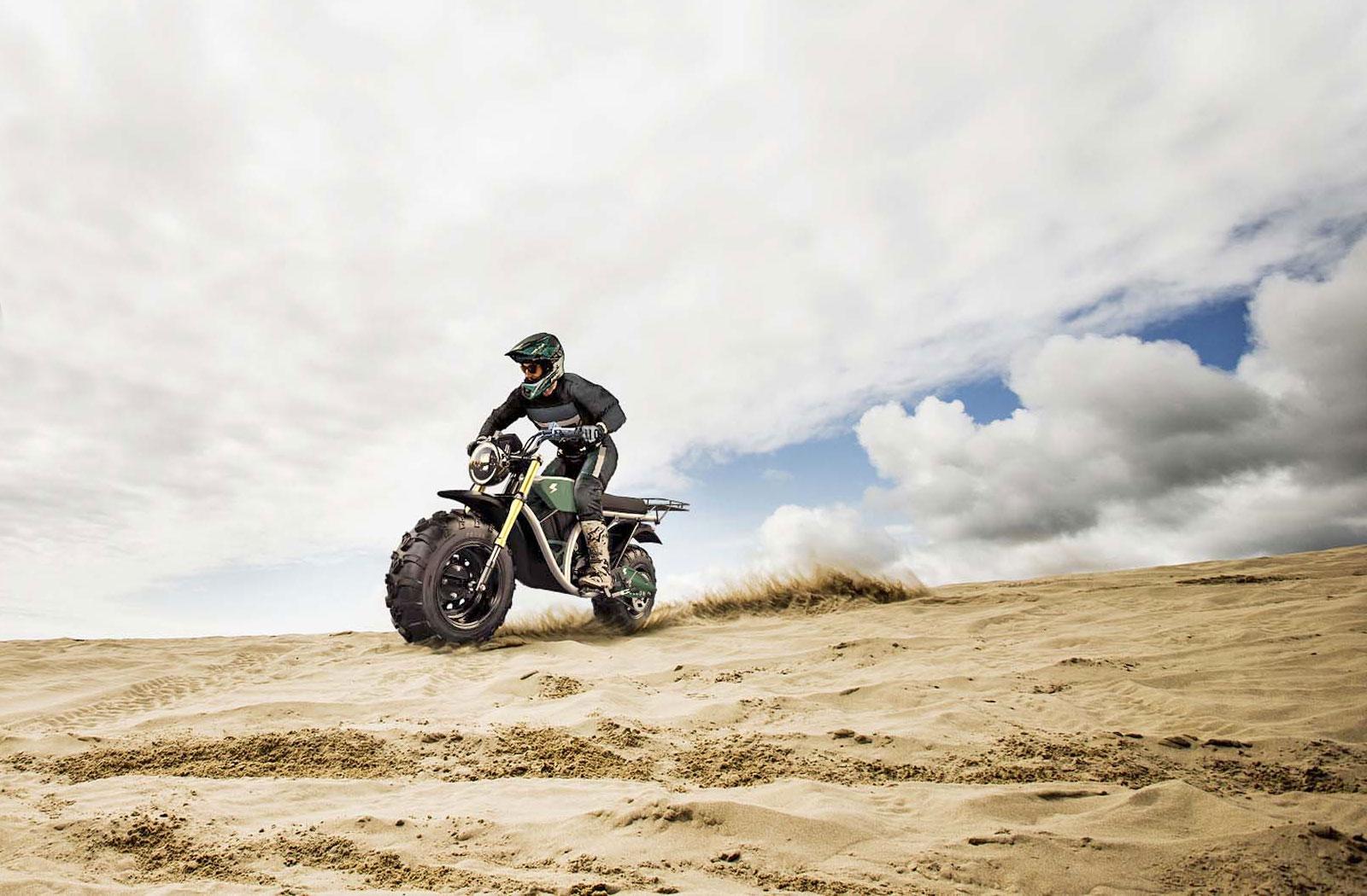Volcon Grunt blasting across a sandy beach