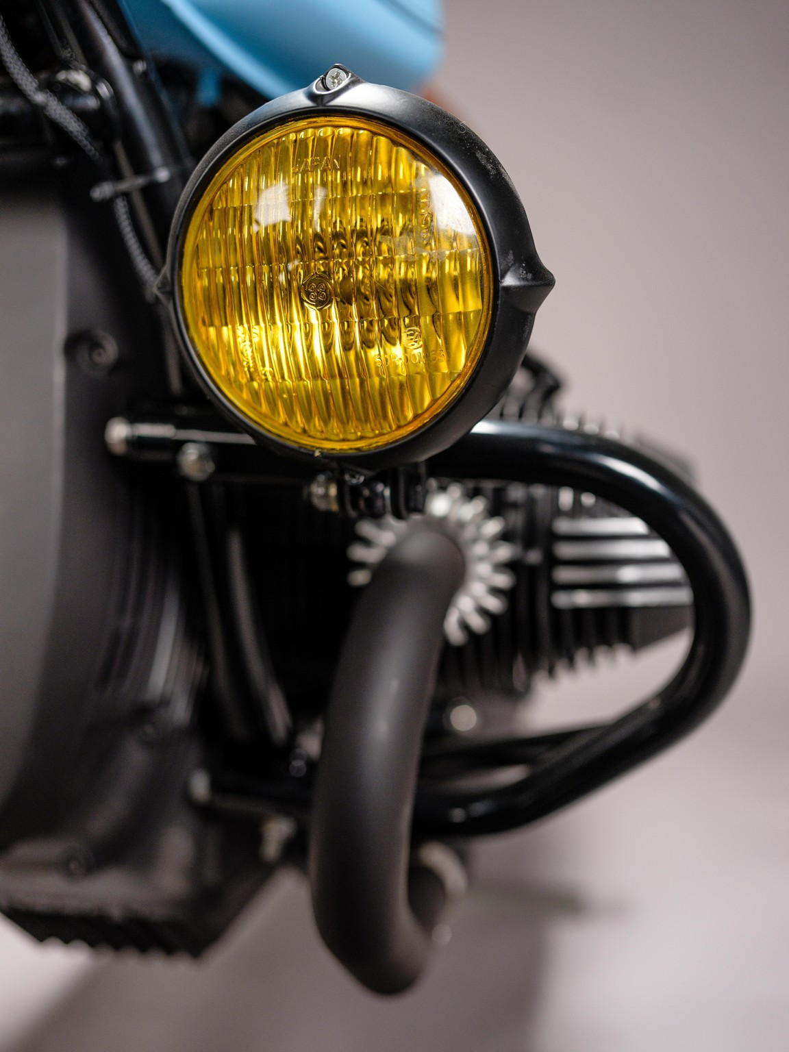 Spotlight detail for custom 1982 BMW R65 Scrambler from AMP Motorcycles in Germany