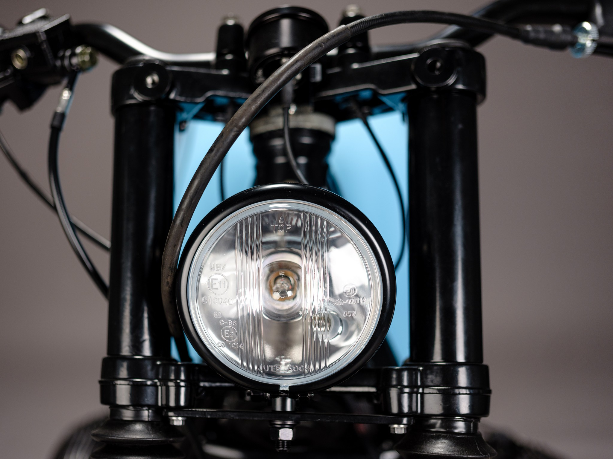 Headlight details for custom 1982 BMW R65 Scrambler from AMP Motorcycles in Germany
