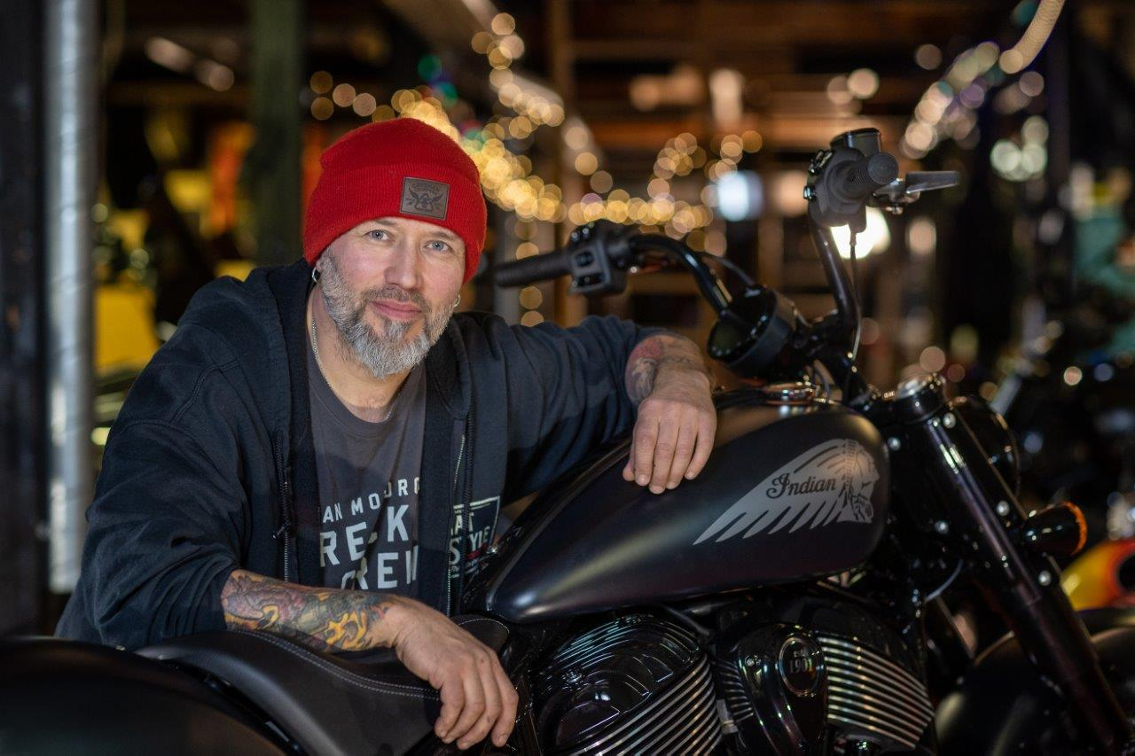 Ola Stenegard, Design Director for Indian Motorcycles leans on a new Chief model
