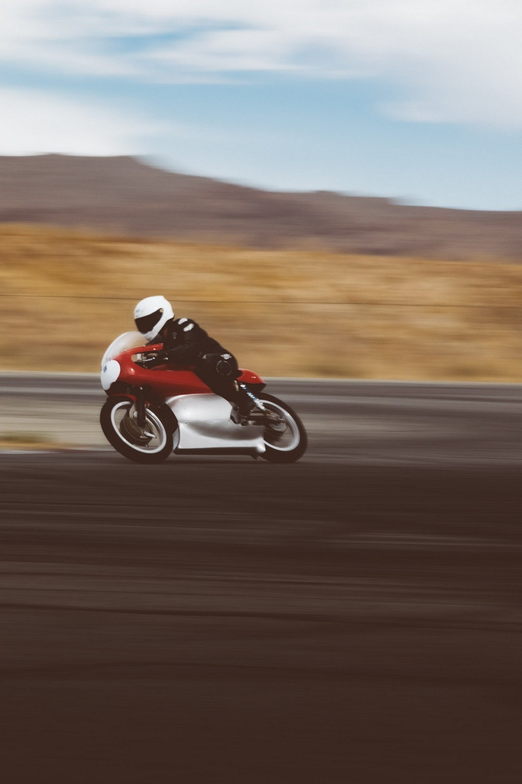 Red motorcycle racing on a track