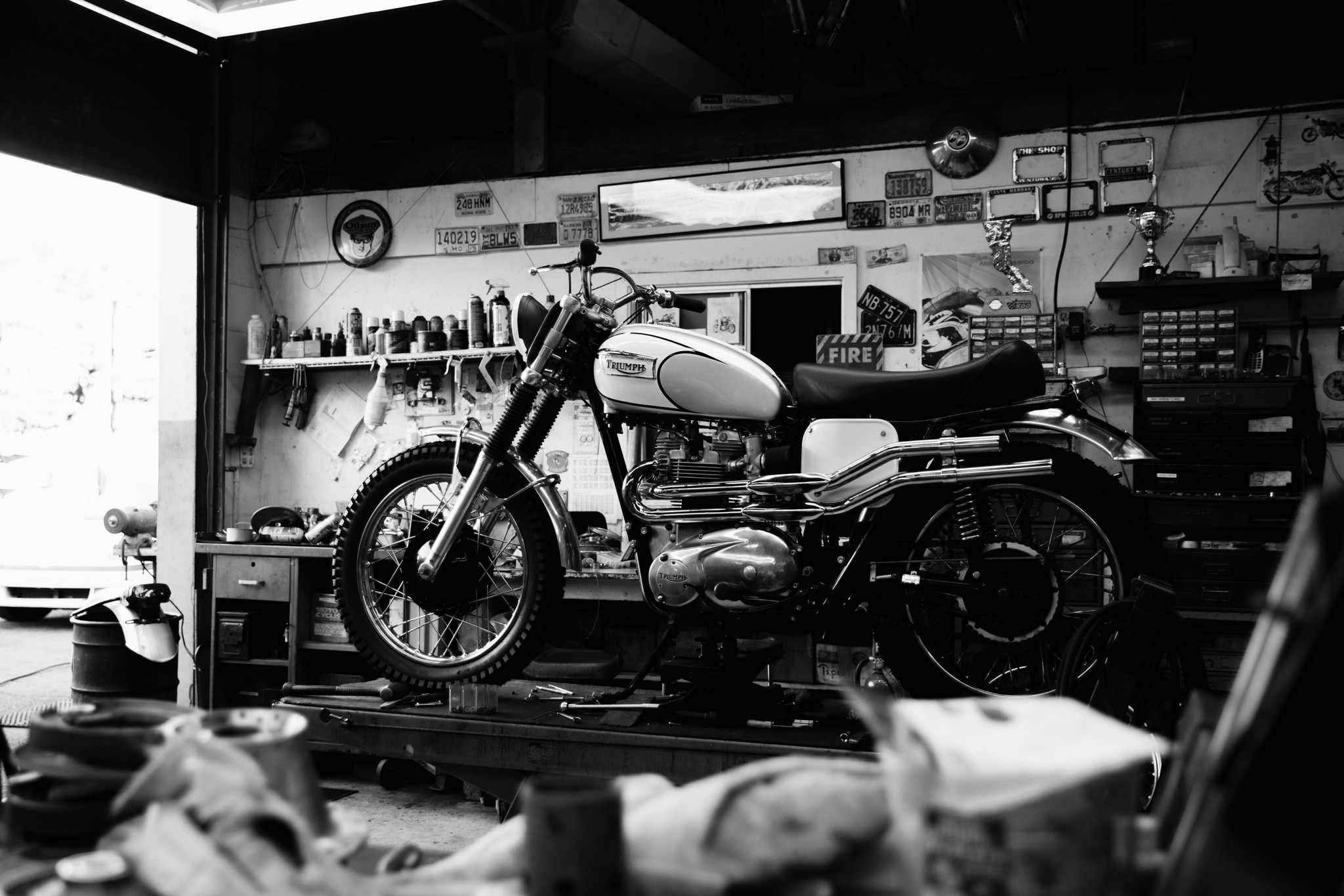 Black and white photo of a Triumph Motorcycle in a workshop
