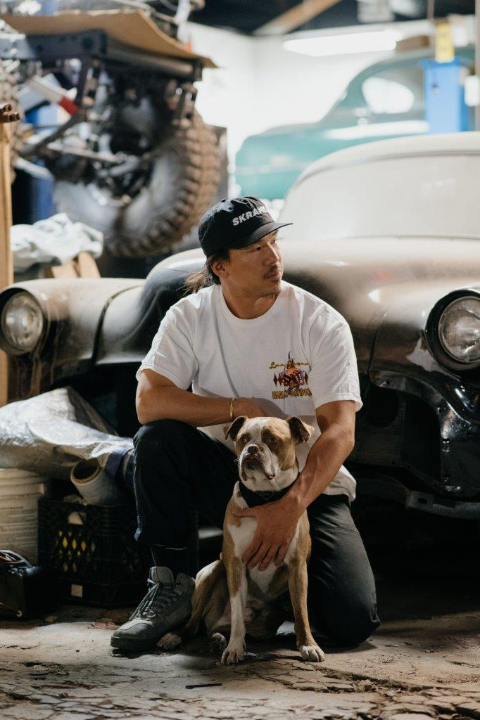 David Chang from Cafe Racers of Instagram in a garage with his dog