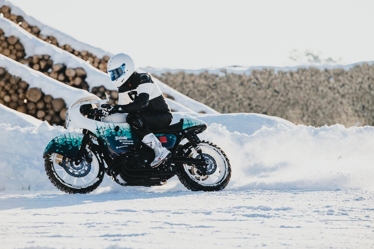 David Chang from Cafe Racers of Instagram on a Triumph motorcycle riding in snow