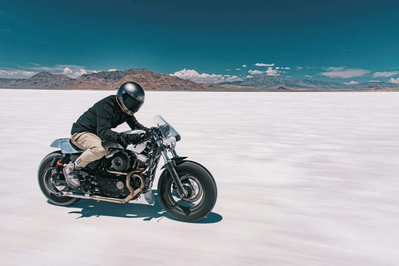 David Chang from Cafe Racers of Instagram on a Harley motorcycle riding on a salt flat