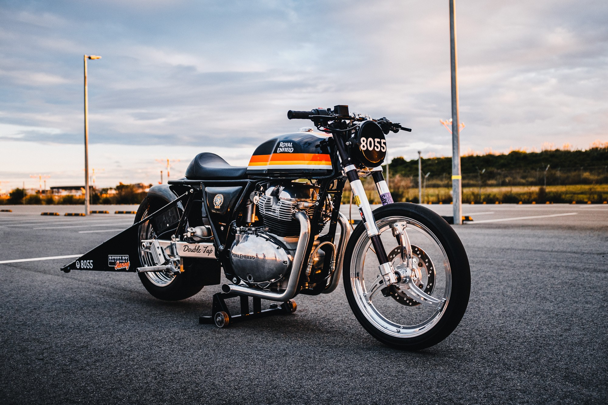 A Royal Enfield 650 Twin drag bike in a Sydney car park at sunset