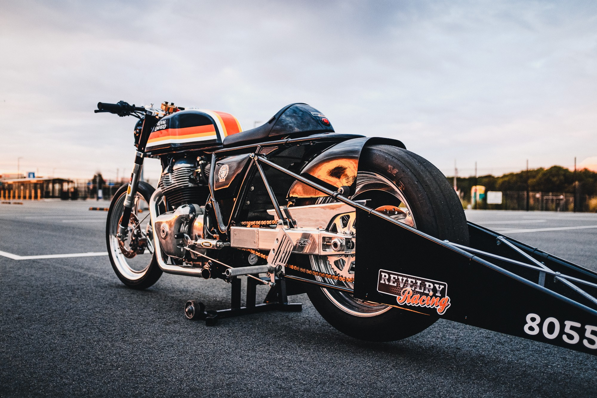 A royal Enfiled 650 Twin drag bike in a Sydney car park at sunset