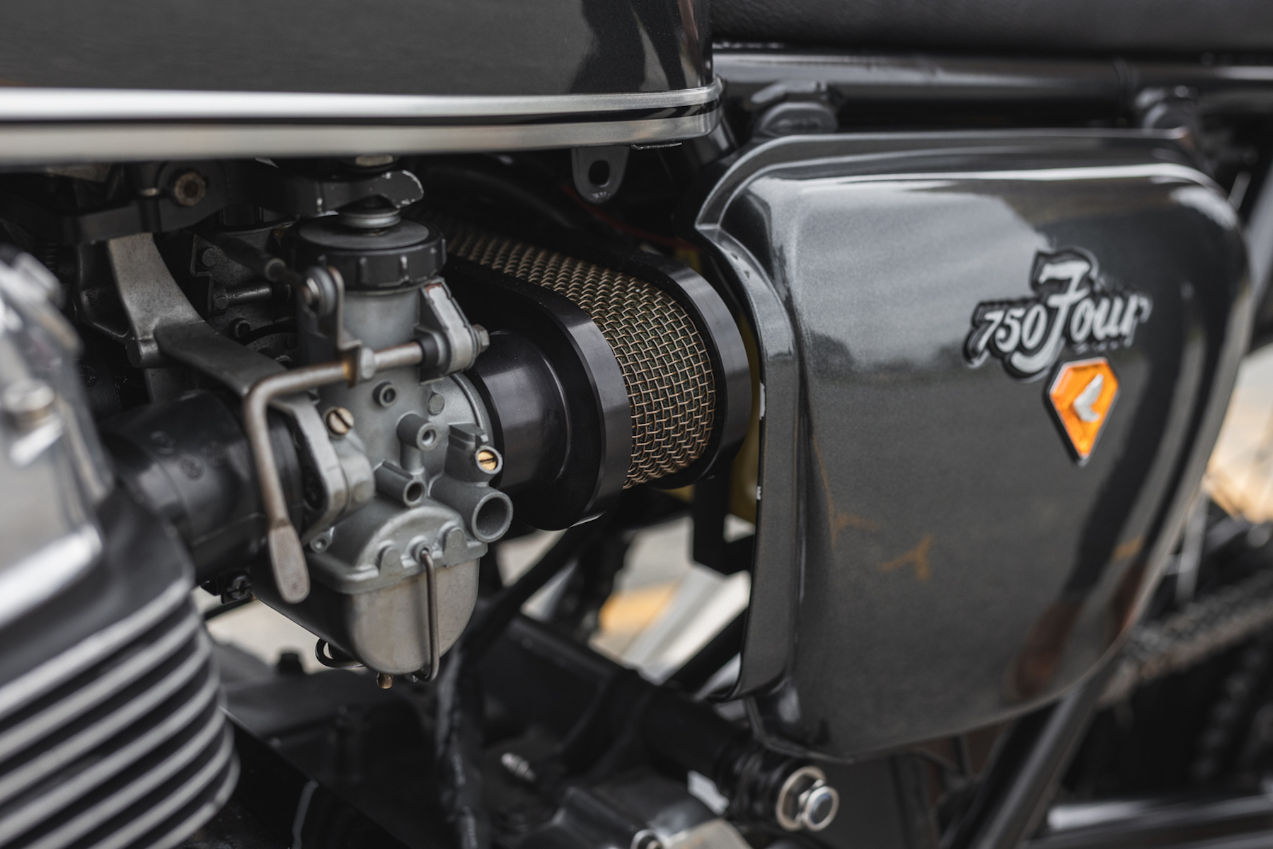 A close-up of a Honda CB750, focusing on the body and chassis of the bike.